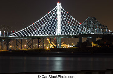 Bay Bridge, San Francisco, California - A night view of Bay...