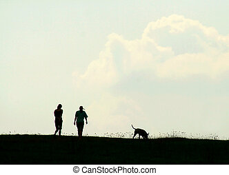 silhouete - silhouette of two girls and a dog