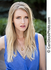 Young blonde woman  - Portrait of young blonde woman