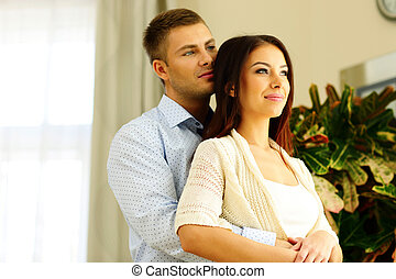 Portrait of a young beautiful couple looking away