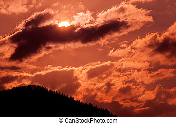 Dramatic sky with sun and clouds