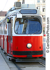 red tram carries passengers for European cities - ecological...