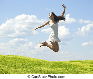 jumping woman - happy jumping woman against nature...
