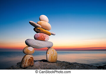 Inukshuk - Figure of inukshuk on the seacoast against the...