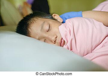 Asian boy sleeping.