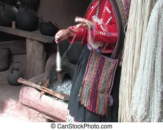 Woman spinning wool, Peru