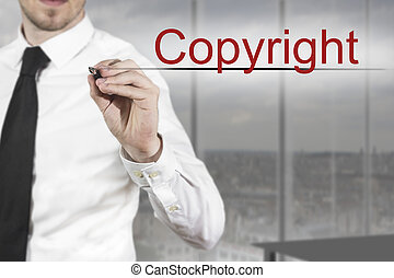 businessman writing copyright in the air - businessman in...