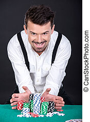 Poker - Smiling poker player is going to all-in, on black...