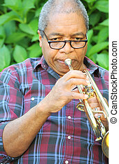 Trumpet Player - African american male trumpet player.