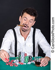 Poker - Man is playing poker in casino Gambling chips, cigar...