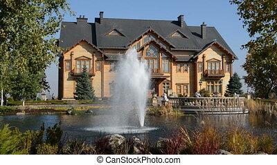 """The fountain and """"Khonka"""" house in Mezhigirya, Ukraine. It..."""