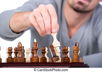 Chess - Close-up hand with chess is making the move on the...