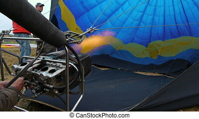 A hot air balloon gets inflated by propane gas -...