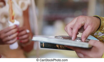 Priest with ring - Wedding ring takes priest with Bible