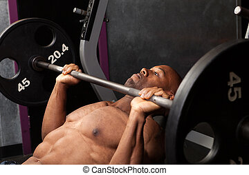 Incline Bench Pressing - Weight lifter at the bench press...