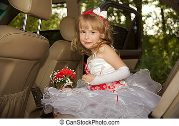 Bridesmaid - The little girl in a celebratory dress.