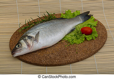 Raw seabass fish with herbs - ready for cooking