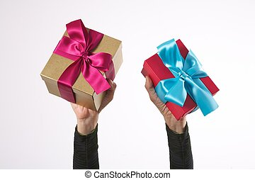 isolated two gifts in woman arms
