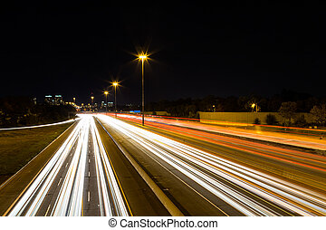 Light Trails on a Highway - A view of Light trails on a...