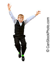 winner - Cheerful ten years schoolboy jumping for joy...