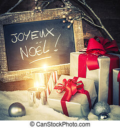 Christmas gifts with lighted candles - Closeup of Christmas...
