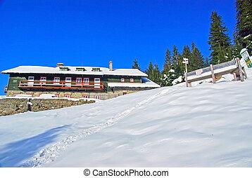 Mountain cabin in winter, Romanian Carpathians.
