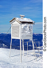 Meteorological station, frozen thermometer in winter.