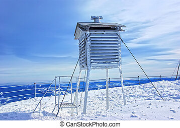 Frozen weather station - Thermometer at weather station on...