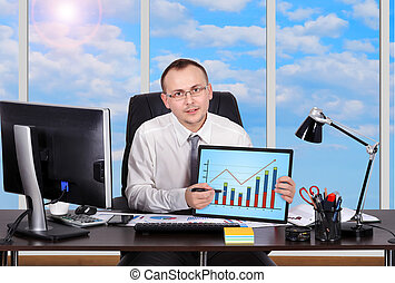 touch pad with chart - young businessman holding touch pad...