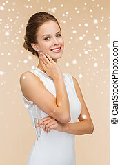 smiling woman in white dress with diamond ring - holidays,...