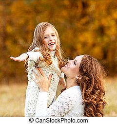 Young mother and her toddler girl have fun, mother's Day.