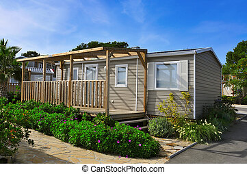 mobile home in a campsite - a nice mobile home with a wooden...