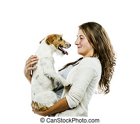 Woman playing with dog isolated - Young woman holding her...