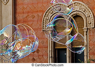 Giant soap bubbles and historic building