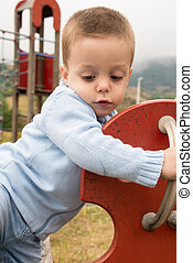 child in a seesaw