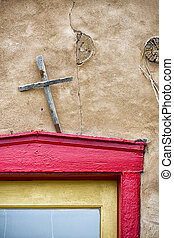 Colorful Door in New Mexico - Cross adorning a multicolored...