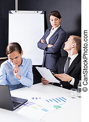 Businesspeople during business meeting - Vertical view of...