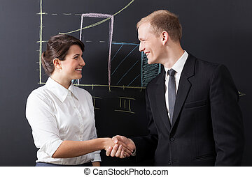 Shaking hands - Portrait of businesswoman and businessman...