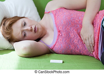 Positive result of pregnancy test - Teenager lying on bed...