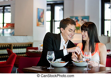 Couple Dining in Restaurant - A young and attractive couple...
