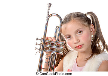 a pretty little girl with a trumpet look at the camera