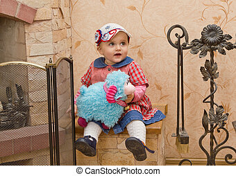 little girl with toy