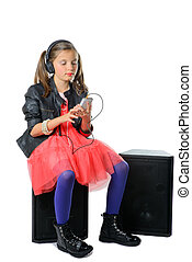 a young girl listening to music on his phone and headphone