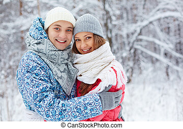 Couple in winterwear - Portrait of happy young dates...