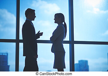 Colleagues talking - Outlines of business partners talking...