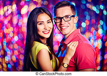 Couple dancing - Affectionate couple looking at camera while...