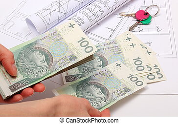 Money, home keys and construction drawings of house