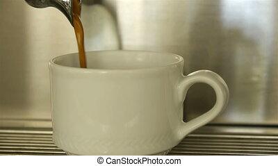 Making espresso coffee in a coffee - Pouring espresso coffee...