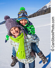 Happy kids playing winter - Two happy kids playing winter on...