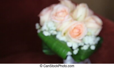 bridal bouquet of cream roses and green leaves with diffuse